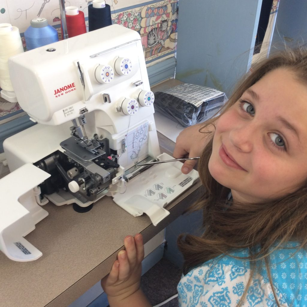 Leah, threading a serger.